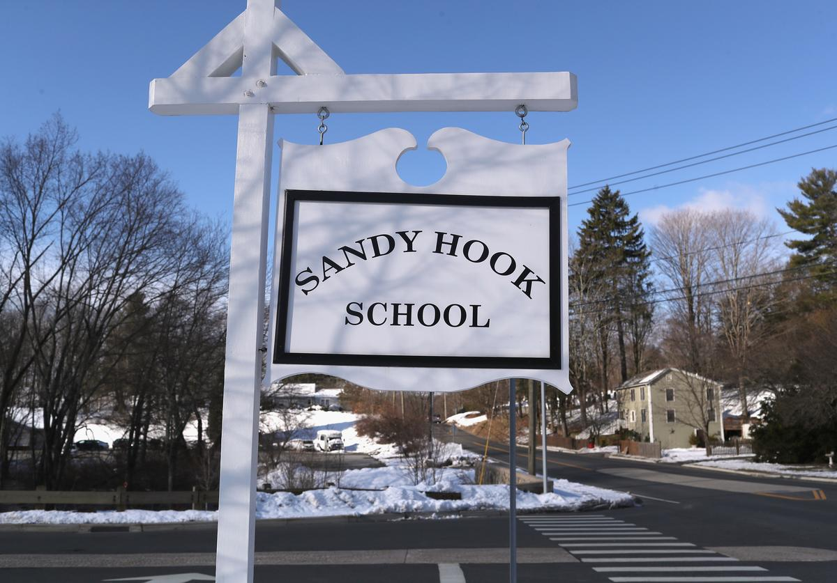 A sign stands near the site of the December 2012 Sandy Hook school shooting on the day of the National School Walkout on March 14, 2018 in Sandy Hook Connecticut