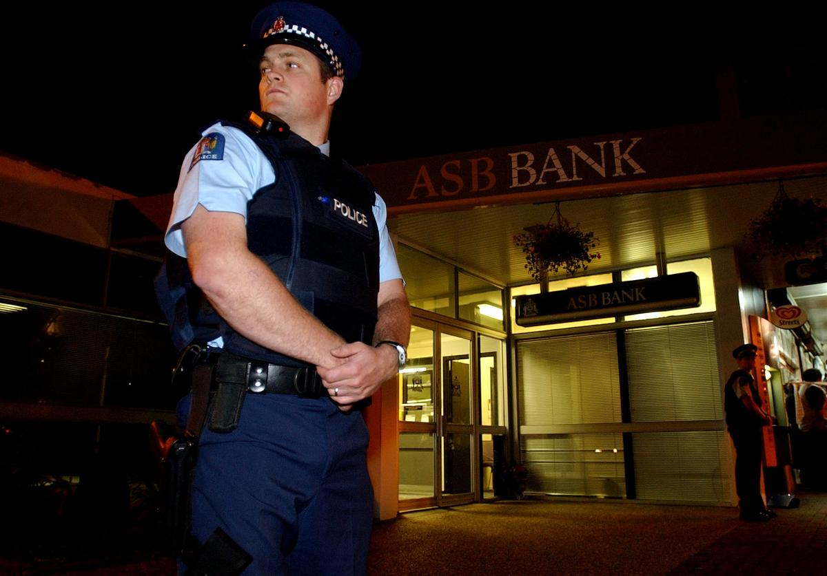 Officer in front of bank