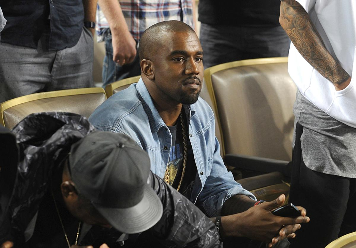 In this handout photo provided by the Los Angeles Dodgers, Kanye West attends the New York Mets v Los Angeles Dodgers game at Dodger Stadium on August 14, 2013 in Los Angeles, California. (Photo by Juan Ocampo/Los Angeles Dodgers via Getty Images