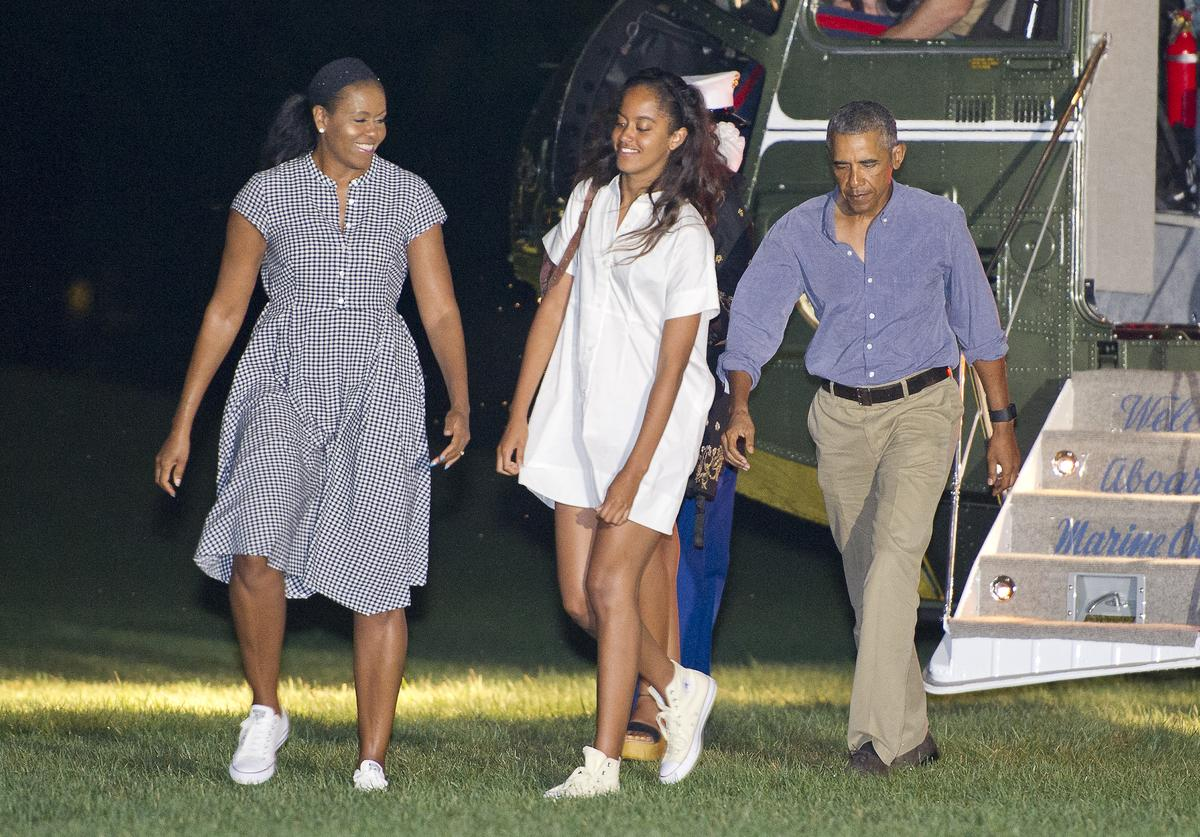 The Obamas returning from vacation