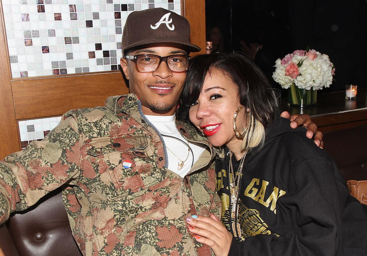 T.I. and Tameka Tiny Cottle-Harris attend Moet Rose Lounge presents T.I., a celebration for his new album Trouble Man: Heavy is The Head at Baoli on November 20, 2012 in Miami, Florida.