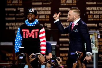 Conor McGregor & Floyd Mayweather Face Off At First Press Conference