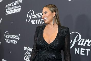 Chrissy Teigen Reveals Growing Baby Bump With Topless Photo