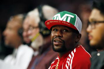 Floyd Mayweather Taunts Conor McGregor By Begging Paparazzi To Film Him