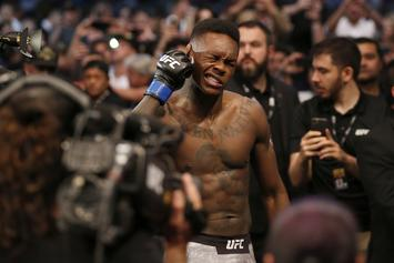 Israel Adesanya Shows Slim Jxmmi His Title Belt & Previews UFC 245