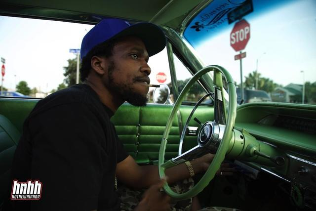 Curren$y drives his vintage green car