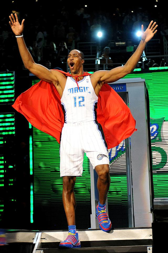 Dwight Howard of the Orlando Magic emerges from a phone booth wearing a Superman cape during the Sprite Slam Dunk Contest on All-Star Saturday Night, part of 2009 NBA All-Star Weekend at US Airways Center on February 14, 2009 in Phoenix, Arizona.