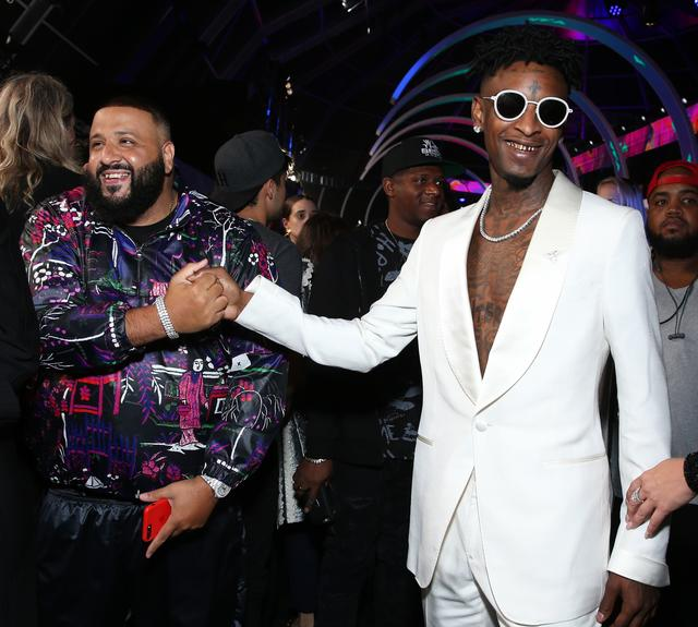 21 Savage shakes hands with DJ Khaled at MTV VMAs