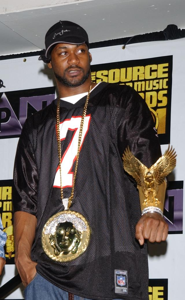 Ghostface Killah with his gold eagle bracelet and versace medallion