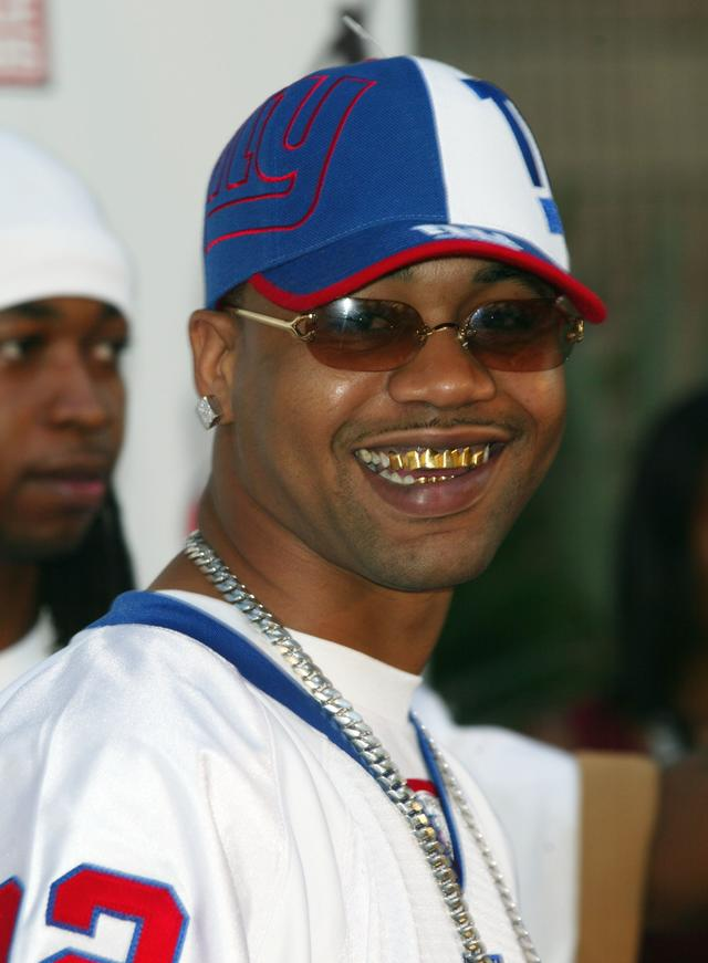 Juvenile shows off his gold grillz in 2003