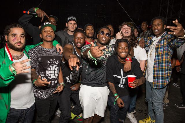 DJ Destructo (4th from the left) poses with the A$AP Mob backstage at the HARD summer music festival at Whittier Narrows Recreation Area on August 2, 2014 in Los Angeles, California.