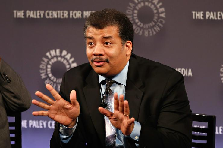 Neil deGrasse Tyson shows the jazz hands.
