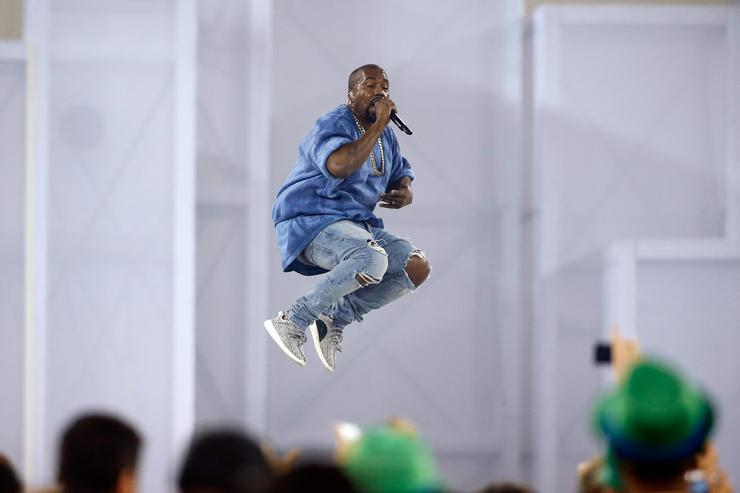 Kanye jumping on stage perfoming