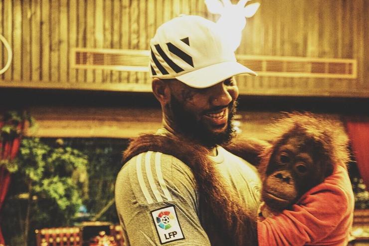 The Game holding a monkey