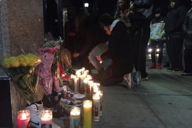 Mourners pay tribute at East Coast Boutique.