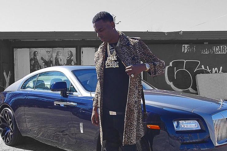 Young Dolph standing aside his Bentley