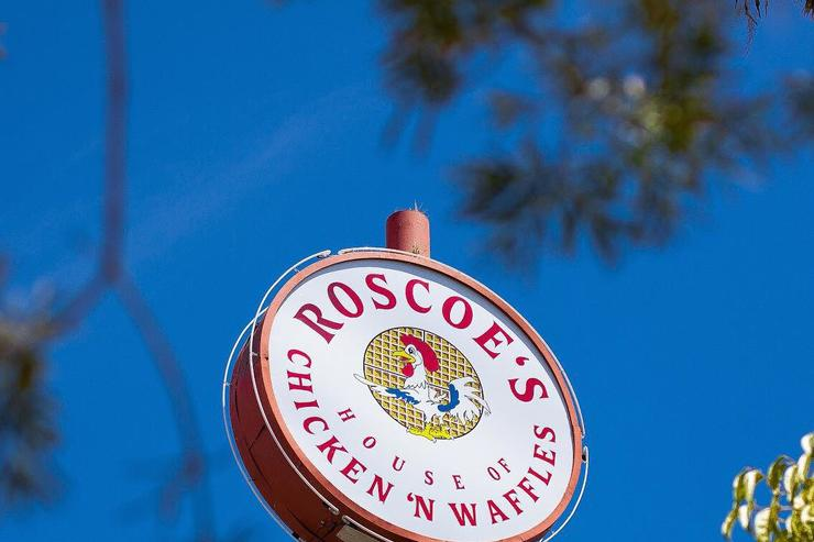 A Roscoe's Chicken N Waffles sign.