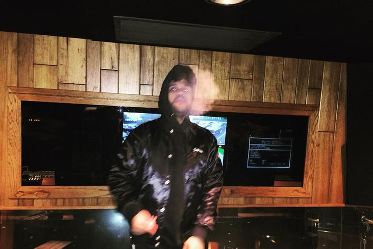 The Weeknd smoking in the studio