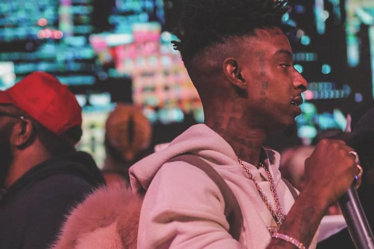 21 Savage with a fluffy backpack