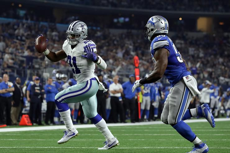 Ezekiel Elliott #21 of the Dallas Cowboys runs for a touchdown past Tahir Whitehead #59 of the Detroit Lions in the third quarter at AT&T Stadium on December 26, 2016 in Arlington, Texas