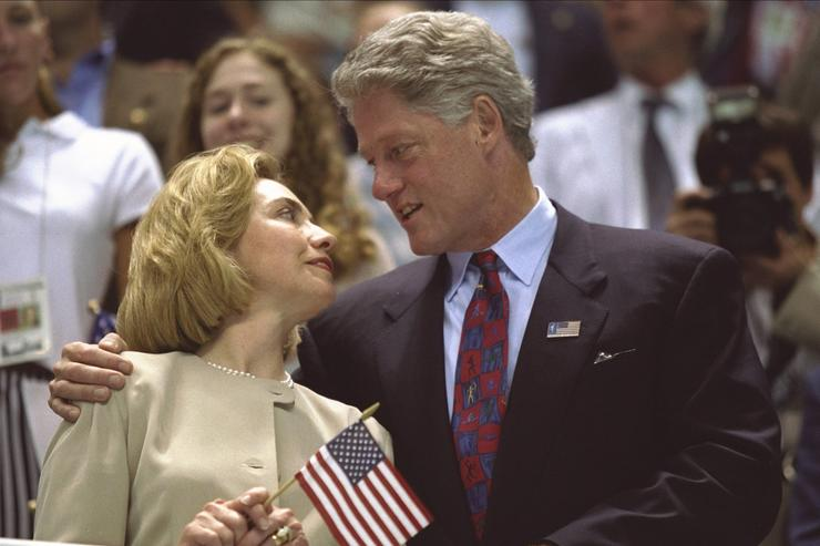 Hillary Clinton, left, and Bill Clinton look to one another as the USA women's 4x200m freestyle relay team wins the gold medal at the Georgia Tech Aquatic Center at the 1996 Centennial Olympic Games in Atlanta, Georgia.