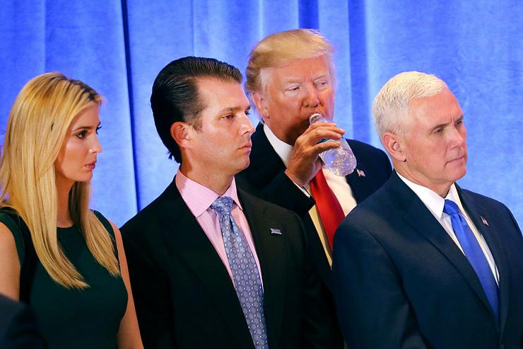 President-elect Donald Trump stands with Vice President-elect Mike Pence, Trump's son Donald Trump Jr. and his daughter Ivanka at a news conference at Trump Tower on January 11, 2017 in New York City. This is Trump's first official news conference since the November elections.