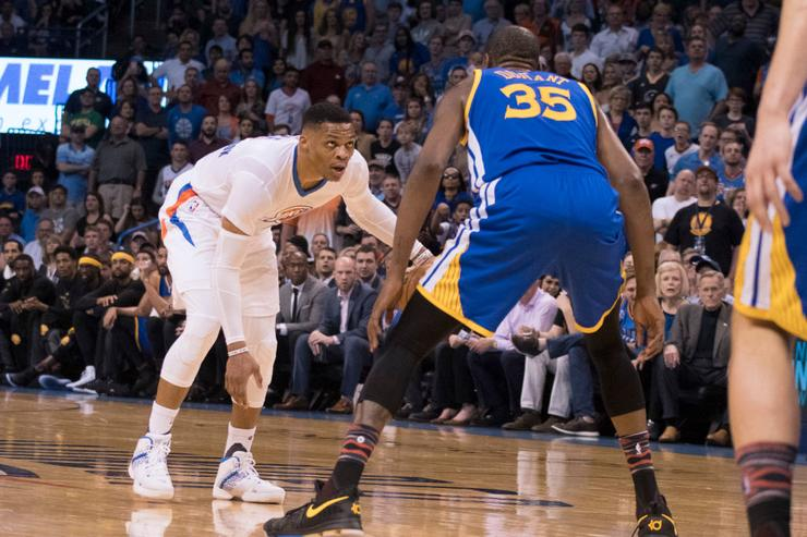 Russell Westbrook #0 of the Oklahoma City Thunder and Kevin Durant #35 of the Golden State Warriors face off during the first half of a NBA game at the Chesapeake Energy Arena on February 11, 2017 in Oklahoma City, Oklahoma.