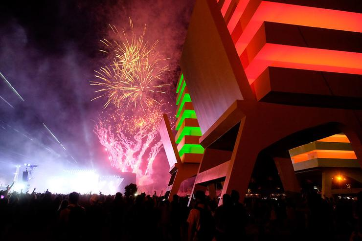 Fireworks are seen through the Katrina Chairs art installation by Alexandre Arrechea during day 3 of the 2016 Coachella Valley Music & Arts Festival Weekend 2 at the Empire Polo Club on April 24, 2016 in Indio, California.