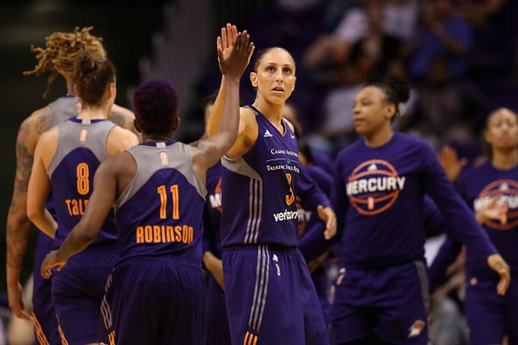 Diana Taurasi #3 of the Phoenix Mercury high fives Danielle Robinson #11