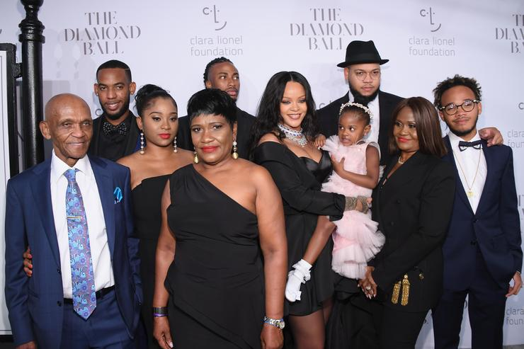 Rihanna and her family pose for a photo at the Diamond Ball