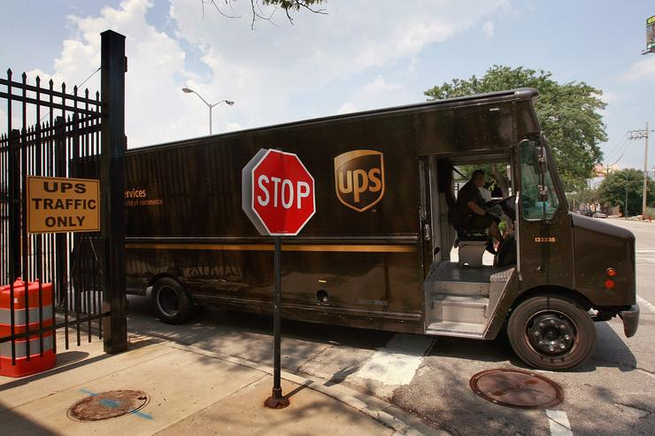 UPS Quarterly Profits Drop Nearly 50 Percent