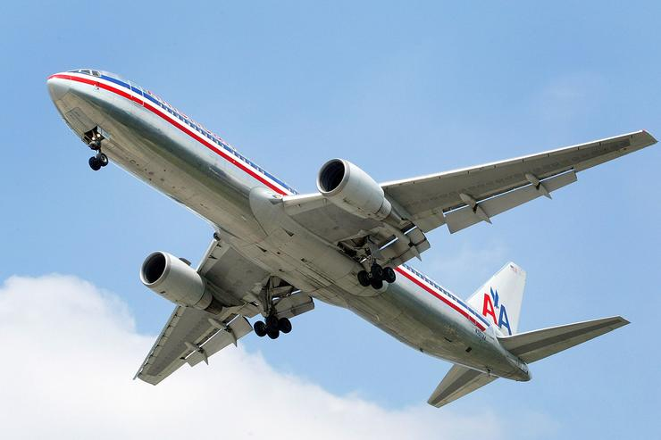 An American Airlines jet is seen in the air preparing to land September 3, 2004 at Chicago's O'Hare International Airport in Rosemont, Illinois. American Airlines announced December 10, 2004 that they will be raising domestic airfares $10 for round-trip and $5 for one-way trips due to jet fuel expense