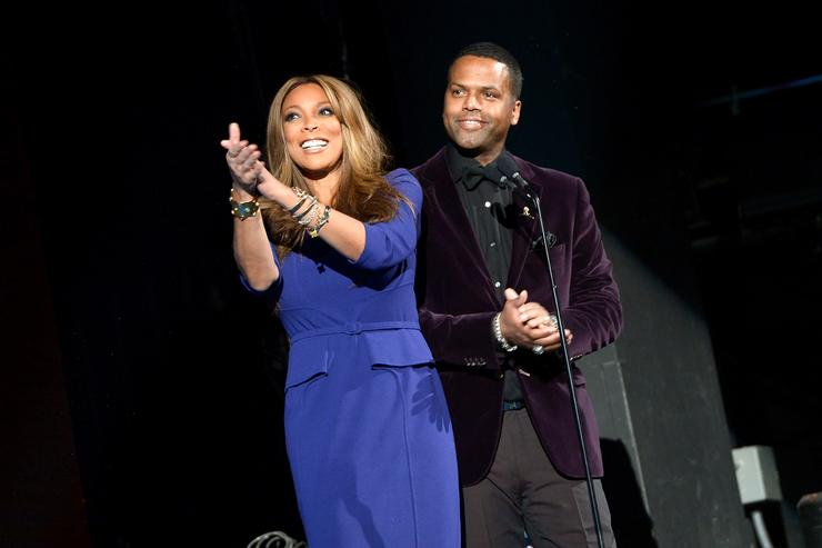 Hosts Wendy Williams (L) and A. J. Calloway speak onstage at the Super Bowl Gospel Celebration 2014 at The Theater at Madison Square Garden on January 31, 2014 in New York City