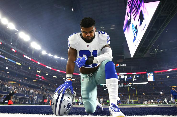 Ezekiel Elliott #21 of the Dallas Cowboys takes a knee in the end zone before the Cowboys played the Detroit Lions at AT&T Stadium on December 26, 2016 in Arlington, Texas