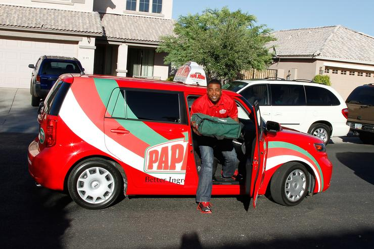 Former NFL Star Cris Carter Delivers Papa John's Pizza to contest winner Anthony Green on September 9, 2010 in Phoenix, Arizona