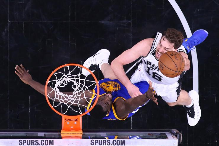Pau Gasol #16 of the San Antonio Spurs takes a shot against Draymond Green #23 of the Golden State Warriors during Game Three of the NBA Western Conference Finals at AT&T Center on May 20, 2017 in San Antonio, Texas