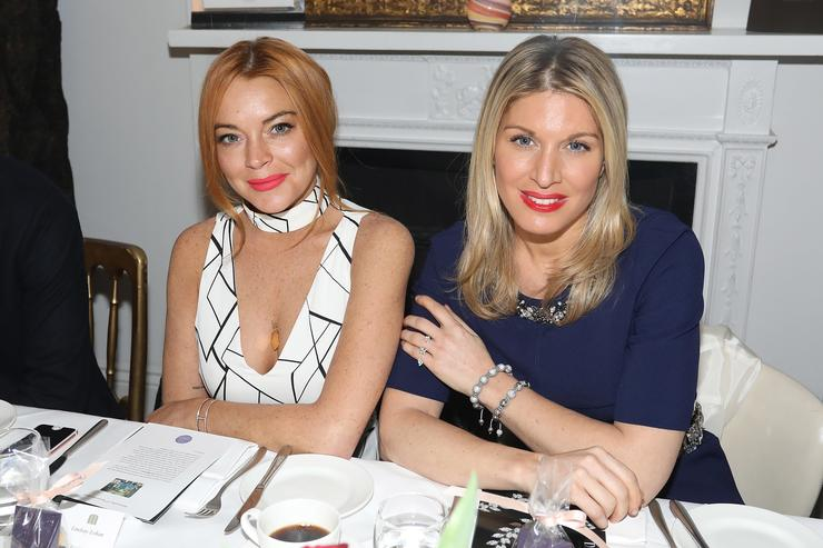 Lindsay Lohan and Hofit Golan attend an afternoon tea hosted by Damiani in aid of Nadedza Foundation at Morton's Club on November 9, 2016 in London, England
