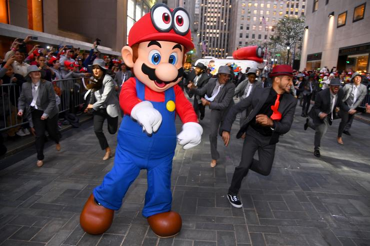 Mario and Jordan Fisher, actor, recording artist and current contestant on Dancing with the Stars co-hosts the Super Mario Odyssey for Nintendo Switch launch event on October 26, 2017 at Rockefeller Plaza in New York City