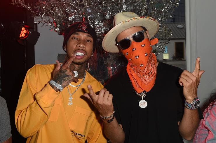 Rapper Tyga (L) and TAG Heuer Art Provacateur Alec Monopoly attend TAG Heuer unveiling of Amgen Tour of California Best Young Rider Jersey with Brand Ambassador Alec Monopoly at Galerie Montaigne on April 25, 2017 in West Hollywood, California