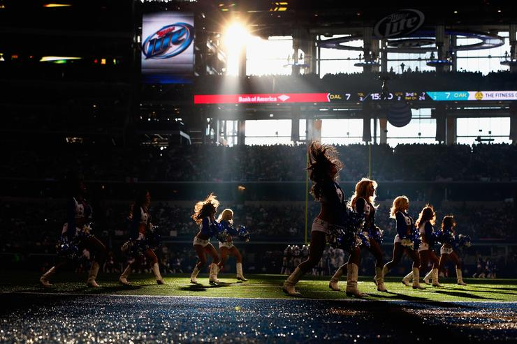 The Dallas Cowboys Cheerleaders perform during a Thanksgiving Day game at AT&T Stadium on November 28, 2013 in Arlington, Texas. The Dallas Cowboys beat the Oakland Raiders 31-24