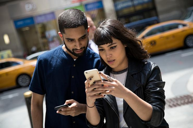 Sameer Uddin and Michelle Macias play Pokemon Go on their smartphones outside of Nintendo's flagship store, July 11, 2016 in New York City. The success of Nintendo's new smartphone game, Pokemon Go, has sent shares of Nintendo soaring