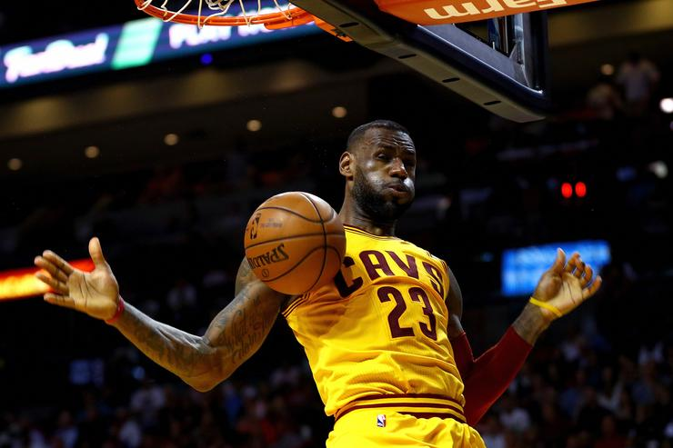 LeBron James #23 of the Cleveland Cavaliers dunks during a game against the Miami Heat at American Airlines Arena on March 19, 2016 in Miami, Florida