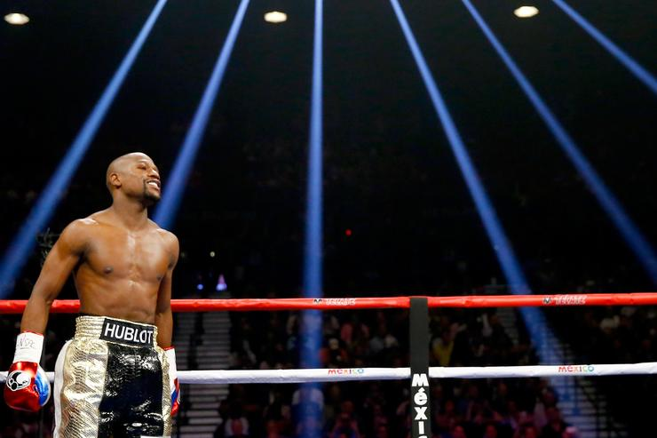 Floyd Mayweather Jr. smiles during the welterweight unification championship bout on May 2, 2015 at MGM Grand Garden Arena in Las Vegas, Nevada.