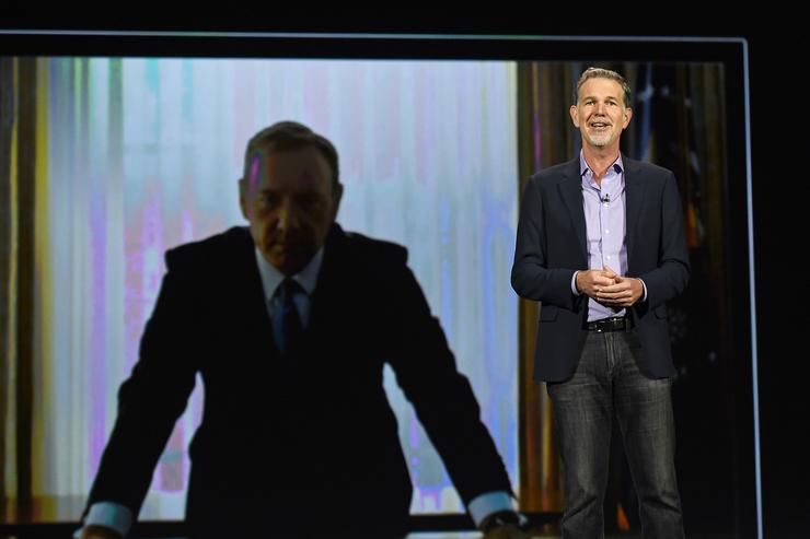Netflix CEO Reed Hastings delivers a keynote address in front of an image of actor Kevin Spacey from 'House of Cards&#039 at CES 2016 at The Venetian Las Vegas