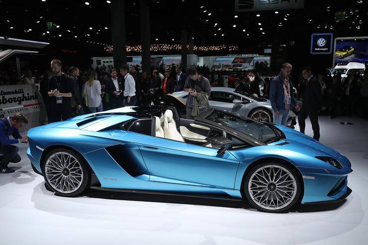 Visitors look at the a Lamborghini Aventador S Roadster at the 2017 Frankfurt Auto Show on September 12, 2017 in Frankfurt am Main, Germany. The Frankfurt Auto Show is taking place during a turbulent period for the auto industry. Leading companies have been rocked by the self-inflicted diesel emissions scandal. At the same time the industry is on the verge of a new era as automakers commit themselves more and more to a future that will one day be dominated by electric cars