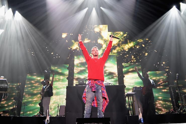 Recording artist J Balvin performs onstage during the iHeartRadio Fiesta Latina festival presented by Sprint at The Forum on November 22, 2014 in Inglewood, California