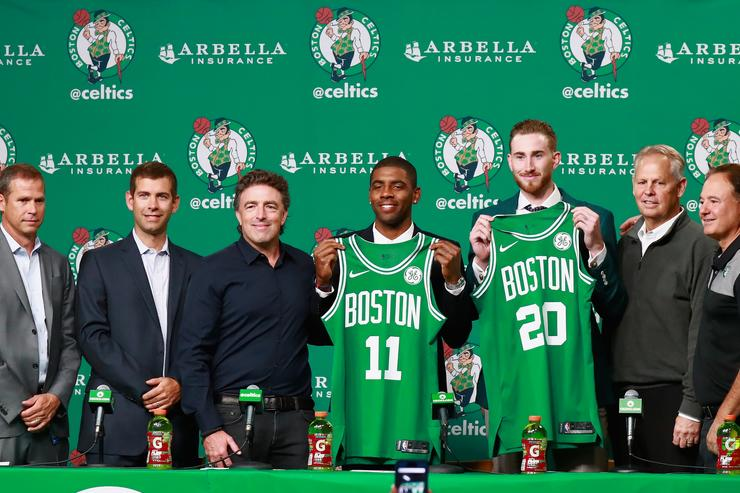 Kyrie Irving #11 and Gordon Hayward are introduced as the newest members of the Boston Celtics at TD Garden on September 1, 2017 in Boston, Massachusetts