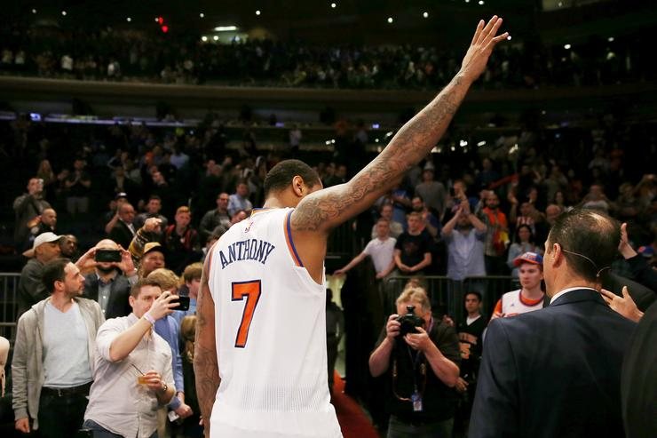 Carmelo Anthony #7 of the New York Knicks waves to the fans as he walks off the court after the 114-113 win over the Philadelphia 76ers at Madison Square Garden on April 12, 2017 in New York City