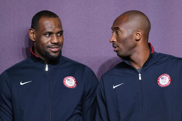 LeBron James (L) and Kobe Bryant (R) look on during a basketball press conference ahead of the London 2012 Olympics on July 27, 2012 in London, England