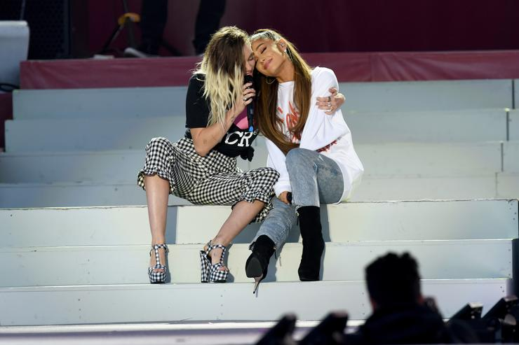 In this handout provided by 'One Love Manchester' benefit concert (L) Miley Cyrus and Ariana Grande perform on stage on June 4, 2017 in Manchester, England